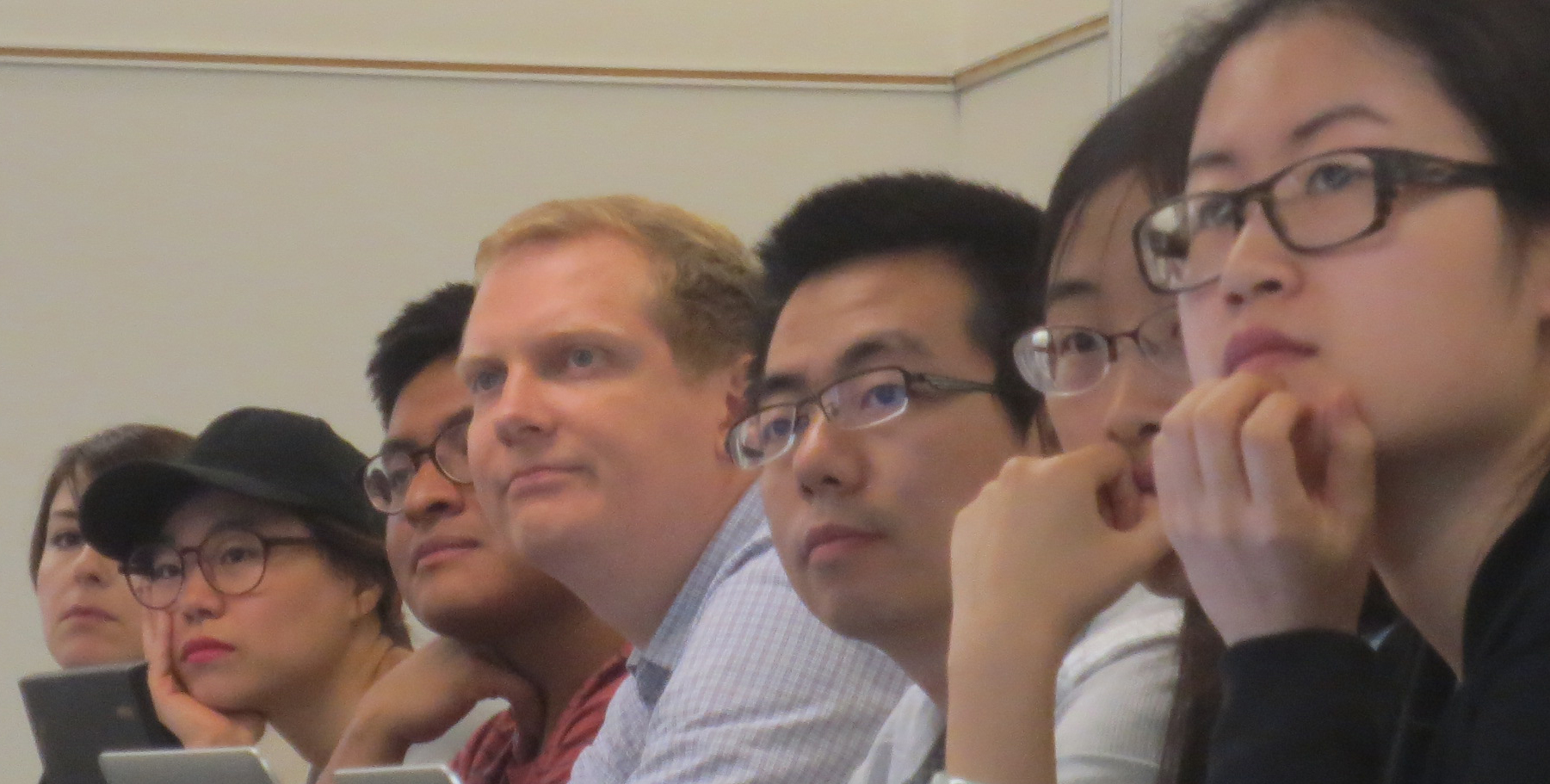 Close up of people in lecture